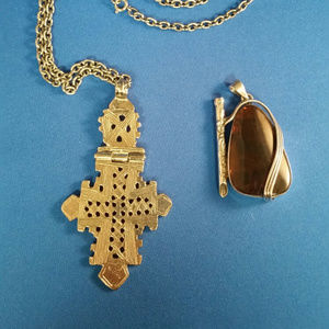Two pendants, one with chain, one without.
